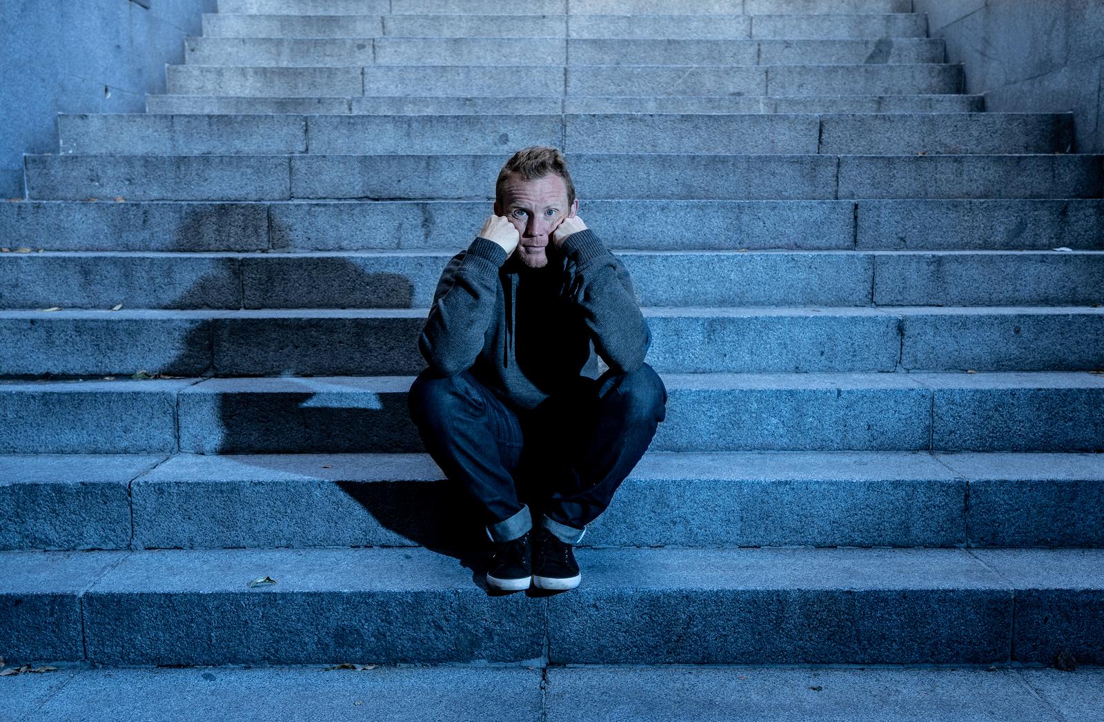 Depressed Sad Young Man Crying Sitting On Stairs Feeling Miserab